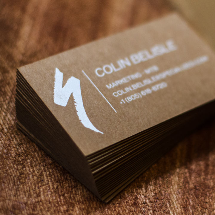 Specialized business cards produced with foil and white silkscreen a top of the line bicycle brand like specialized deserves a top of the line business card these unique cards were produced on 36pt dark brown kraft 100 reheart